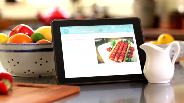 recipe on smart tablet in kitchen - recipe stock videos & royalty-free footage