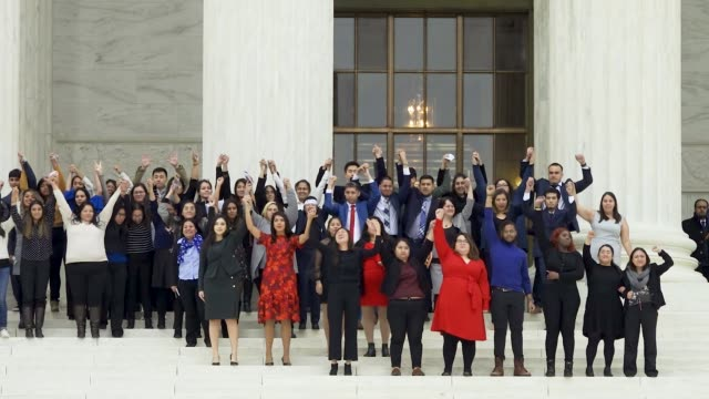 daca recipients exit us supreme court after first day of hearings daca recipients stand before the us supreme court in washington dc on november 12... - oberstes bundesgericht der usa stock-videos und b-roll-filmmaterial