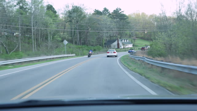 Reckless biker passing cars dangerously
