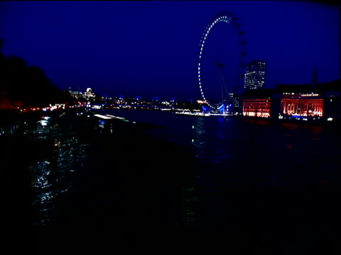 reconstruction of blackout: lights go out in buildings along river thames - cut video transition stock videos & royalty-free footage