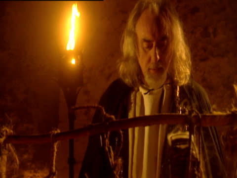 A reconstruction of Merlin working in his apothecary/laboratory.