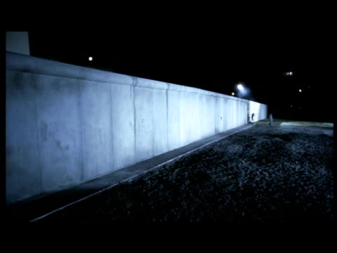 Reconstruction of people escaping through opening in Berlin Wall.
