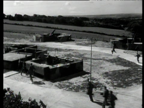 reconstruction of raf ground crew scrambling to defend airbase during attack england 1940 - military base stock videos & royalty-free footage