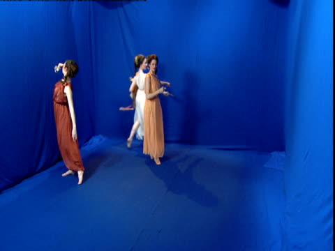 reconstruction of three roman women dancing in front of a blue screen. - toga stock videos and b-roll footage