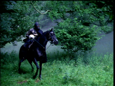 reconstruction of two knights on horseback jousting one is knocked from horse - jousting stock videos and b-roll footage