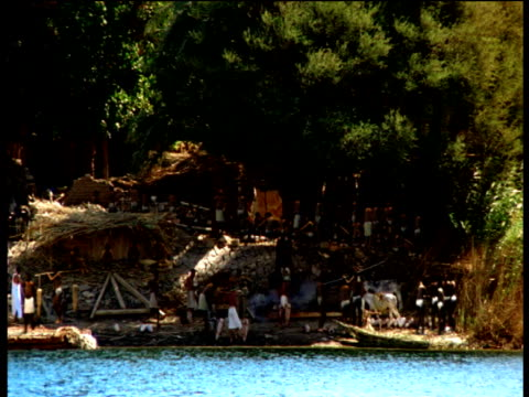 reconstruction panning left across ancient egyptian settlement on banks of river nile giza - river nile stock videos & royalty-free footage