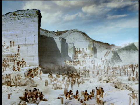 reconstruction panning right around ancient egyptians quarrying stone giza - reenactment stock videos & royalty-free footage