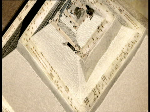reconstruction tracking directly over ancient egyptians building pyramid giza - pyramid stock videos and b-roll footage