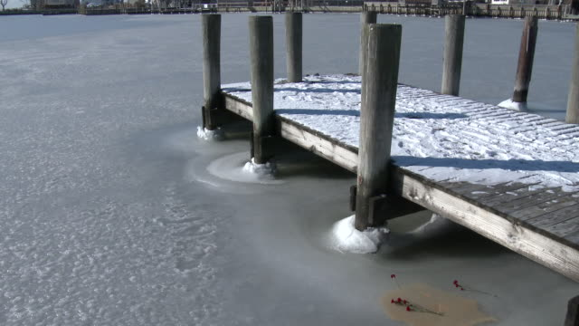 Record cold temperatures cause bays along the south shore of Long Island to freeze solid creating thick ice around a dock at a marina in Lindenhurst...