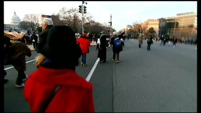 Record crowds arrive in Washington for Barack Obama's inauguration USA Washington DC EXT Group of African American people cheering for camera SOT...