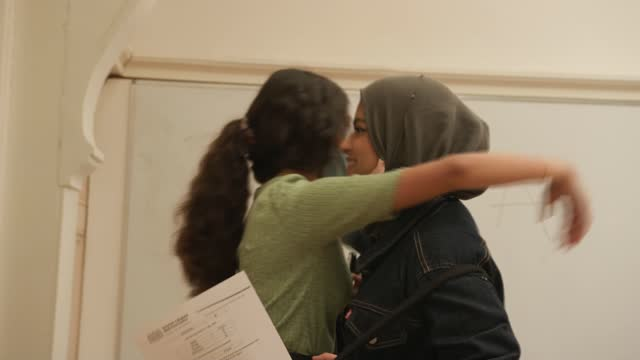 record high in top grade a-level results; england: london: uxbridge: the harefield academy: ext student reading a-level results and reacting with... - top of the pops stock videos & royalty-free footage