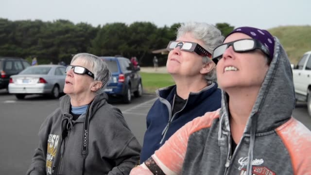 a record number of visitors flock to newport oregon to watch the total solar eclipse - newport oregon stock videos & royalty-free footage