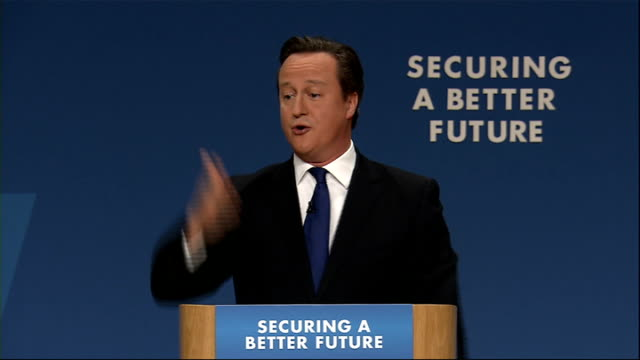 Record number of workers in lowpaid jobs LIB / 1102014 Birmingham INT David Cameron MP delivering speech William Hague MP in audience Cameron...