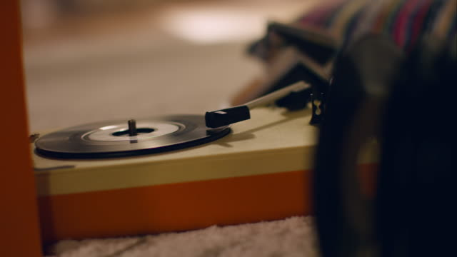 record player on floor playing music - jukebox stock videos & royalty-free footage