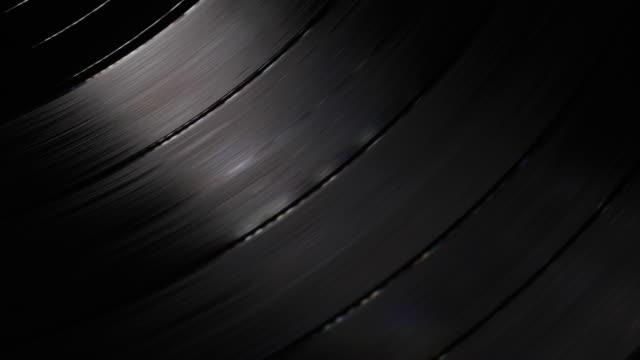 vidéos et rushes de record lp jouant de la musique - couleur noire