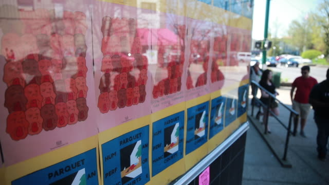 stockvideo's en b-roll-footage met record shoppers in line are reflected in a display window at landlocked records during record store day, april 16, 2016 in bloomington, indiana /... - audio available