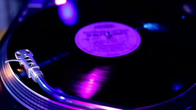 Record spins on turntable