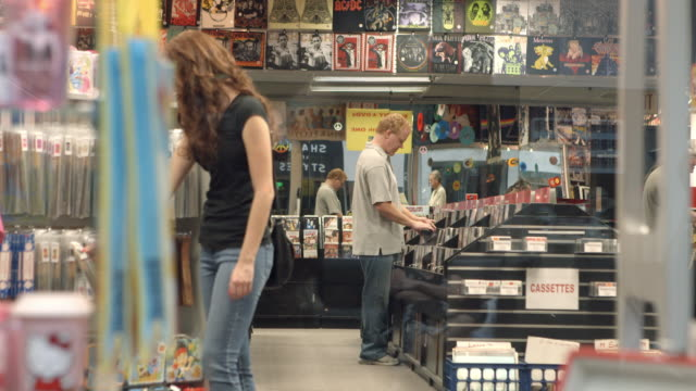 MS TS record store customers shopping for incense and recorded music / Palm Desert, California, USA
