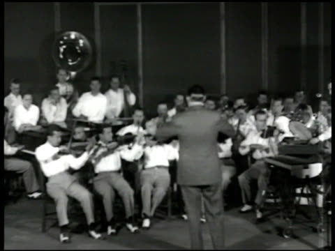 record 'victor whispering by paul whiteman' spinning. vs orchestra leader paul whiteman & orchestra band playing in recording studio . whiteman... - rca stock videos & royalty-free footage