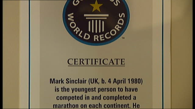 recordbreaking marathon runner returns from illness to partake in london marathon int framed guinness world records certificate and marathon medals... - world record stock videos & royalty-free footage