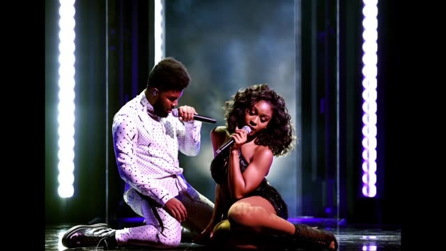 recording artists khalid and normani perform onstage during the 2018 billboard music awards at mgm grand garden arena on may 20, 2018 in las vegas,... - billboard点の映像素材/bロール