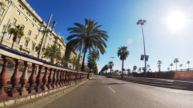 recording barcelona city streets with beautiful architecture landmarks from car point of view with motion in a sunny day and low traffic. - car point of view stock videos & royalty-free footage
