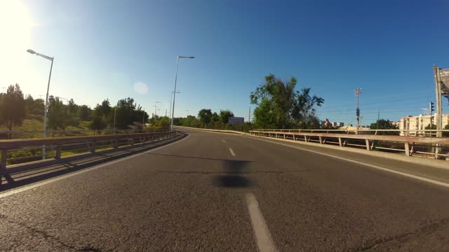 recording barcelona city streets with beautiful concrete urban infrastructures from car point of view with motion in a sunny day and low traffic. - low stock videos and b-roll footage