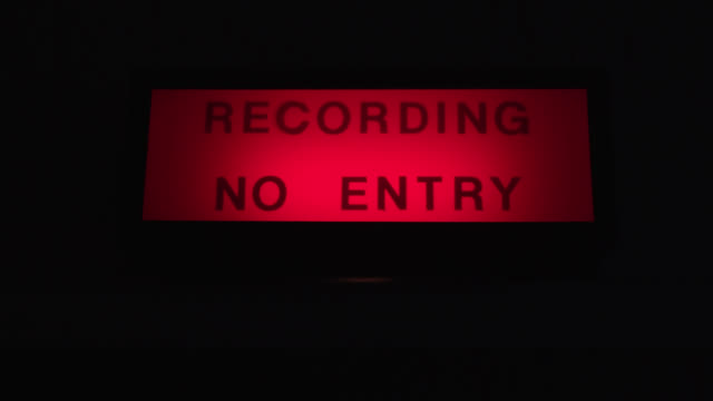 a 'recording no entry' sign flashes red in a recording studio - recording studio stock videos & royalty-free footage