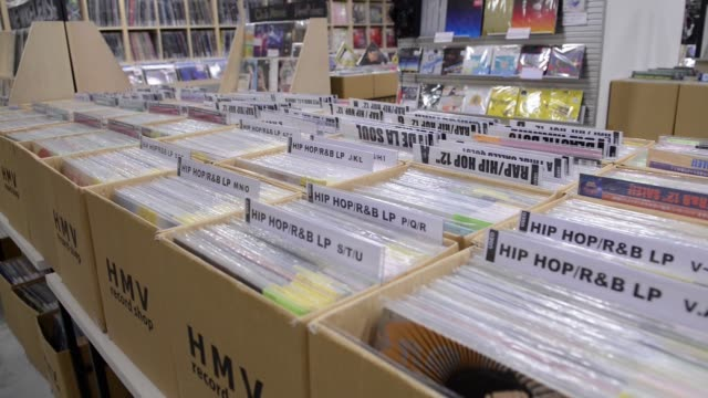 Records are shown on display in bins at the HMV record shop in a shopping district in Shibuya Tokyo JAPAN on Wednesday Sep 28 2016 Shots view of many...