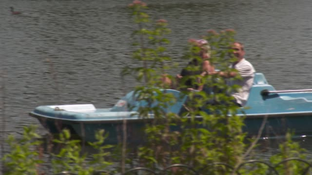 uk records hottest day of the year england london regent's park ext couple on pedalo in the boating lake / people relaxing in park - paddle boat stock videos & royalty-free footage