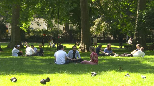 records hottest day of year so far; 16.7.2021 england: london: ext / sunny fountain in park people sunbathing on grass in park children playing in... - sunlight stock videos & royalty-free footage