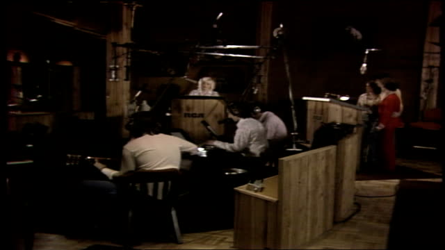 records' studio b in nashville / tape spool rolling on an analog 24 track recorder / engineer bob ferguson and producer porter wagoner at mixing... - television show stock-videos und b-roll-filmmaterial