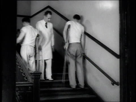 Recovering patients practicing with crutches on stairs / United States