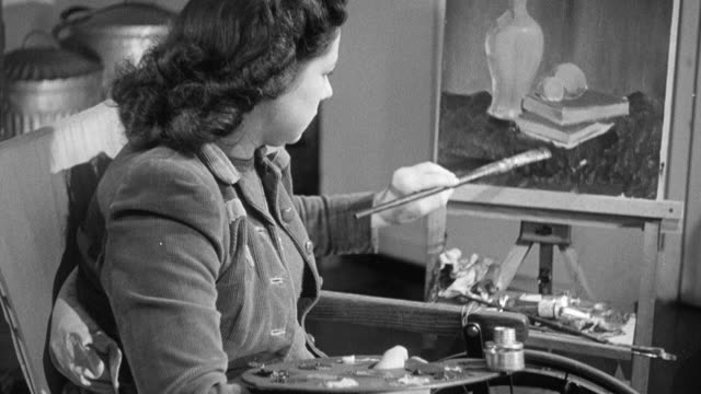 1949 montage recovering polio patients painting and using a loom / united kingdom - polio stock videos & royalty-free footage