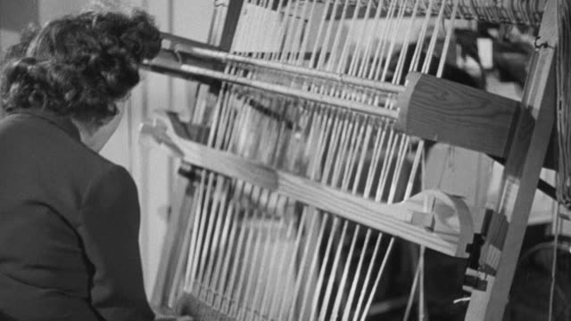 1949 montage recovering polio patients sewing and using a loom in physical therapy center / united kingdom - polio stock videos & royalty-free footage