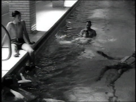 Recovering WWII amputees and other patients swimming in pool / United States
