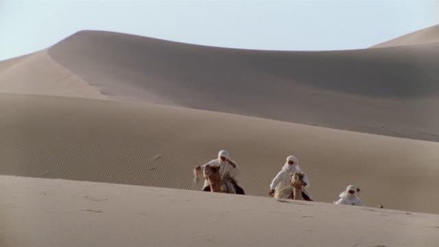 MS, PAN, Re-creation, Africa, Tuareg tribesman riding camel in desert, rear view