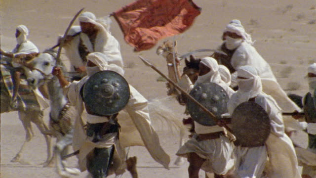 SLO MO, CU, PAN, Re-creation, Africa, Tuareg troops running through desert