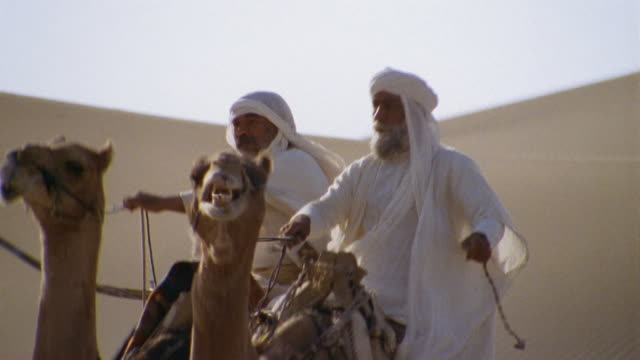 CU, TD, Re-creation, Africa, Two Tuareg tribesmen riding camels through desert