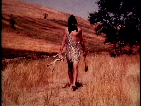 re-creation ws caveman walking in field with primitive tools made from animal antlers and bones / usa - animal creation stock videos & royalty-free footage