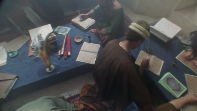 recreation cu zo ws muslim men writing on tablets with quill pens and studying in mosque / istanbul, turkey - writer stock videos and b-roll footage