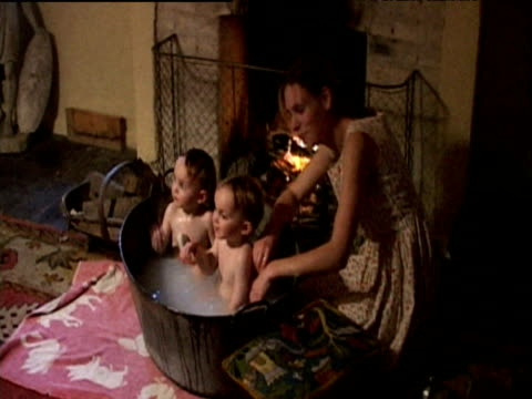 Recreation Of Mother Bathing Two Babies In Tin Tub In Front Of ...
