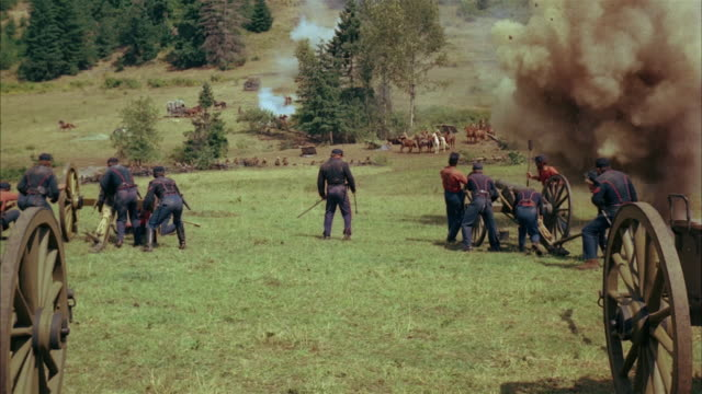 recreation wide shot union soldiers falling down after being hit by cannon fire during civil war battle - cannon stock videos & royalty-free footage