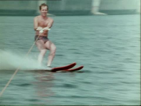 1974 recreational activities, water-skiing, playing frisbee / netherlands - waterskiing stock videos & royalty-free footage