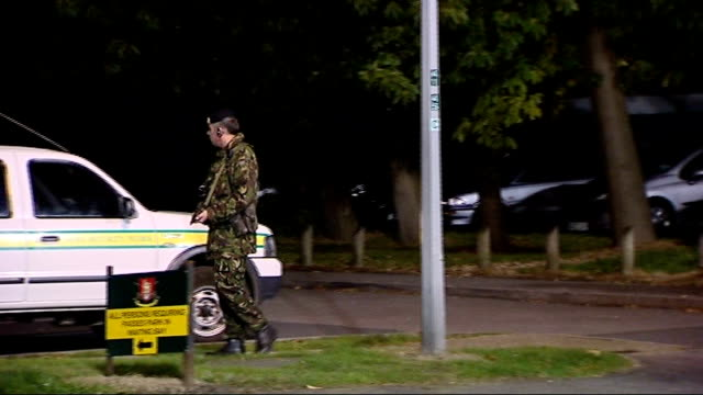 stockvideo's en b-roll-footage met recruit found hanged at pirbright army camp; england: surrey: pirbright army camp: ext / night electronic sign 'welcome to atc pirbright' var along... - var