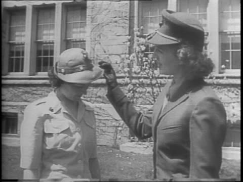 recruiting drive for women marines stepped up by exhibition of summer uniforms / a woman in uniform smiles brightly for the camera / the women line... - us marine corps stock videos & royalty-free footage