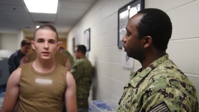 recruits receive vaccinations at uss red rover in-processing medical and dental facility at recruit training command . about 38,000 to 40,000... - military recruit stock-videos und b-roll-filmmaterial