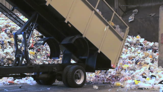 recycle,  recycling, landfill, garbage, green, environment, waste, dump, trash - dump truck stock videos and b-roll footage