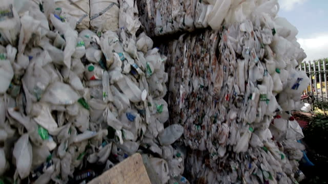 recycled plastic bottles in stacks. - hay bail stock videos & royalty-free footage