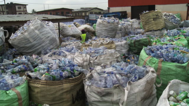 recycling cans and bottles in africa - cross section stock videos & royalty-free footage